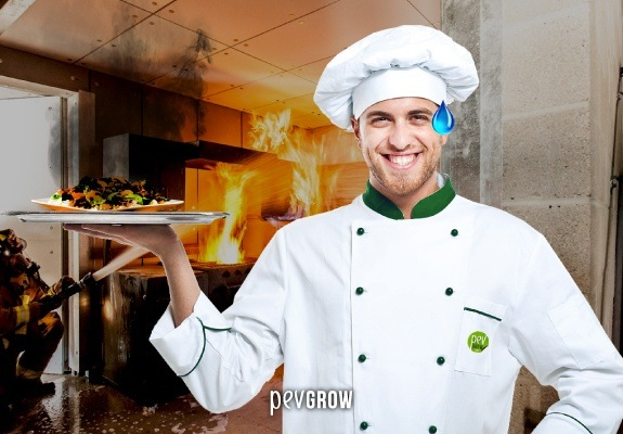 Picture of a cook smiling despite all the incidents in his kitchen.
