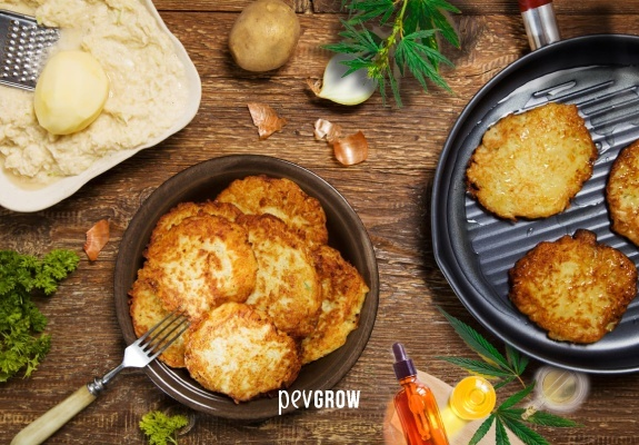 Image of delicious latkes on a plate with the odd bud on the table as a garnish.